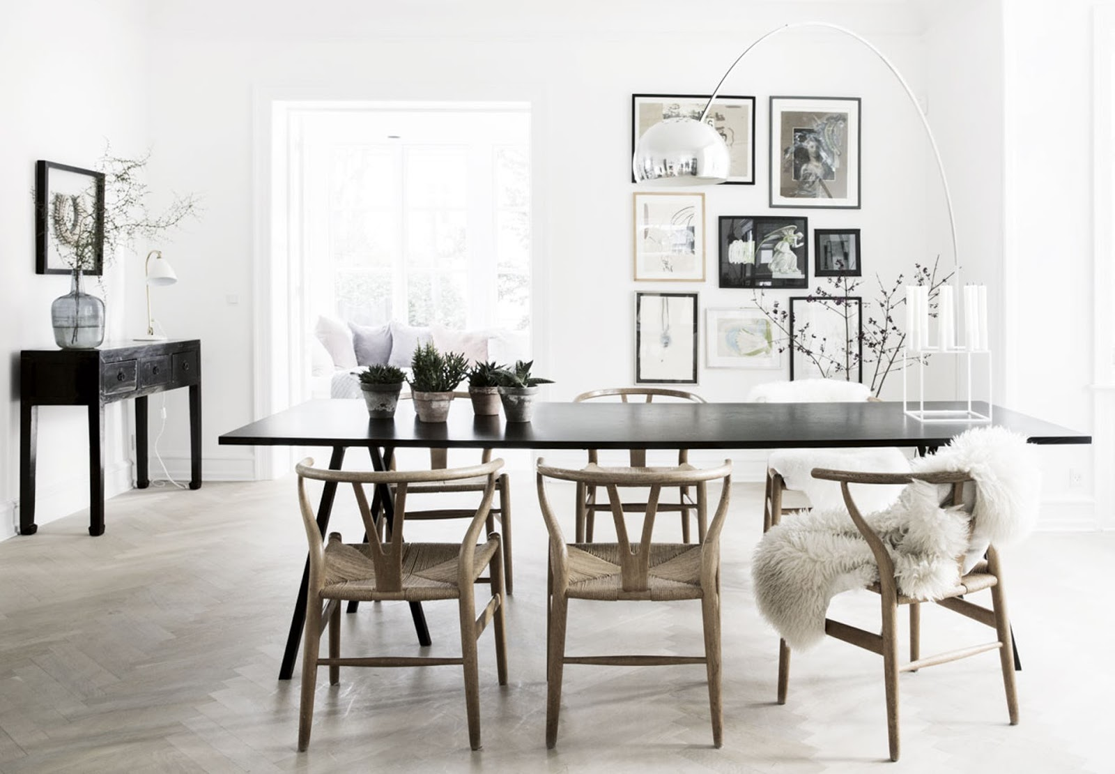 Bright scandinavian interior in nordic villa with hans wegners chairs and black furniture