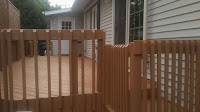 Back Deck. Re-stained, repaired, pressure  washed, 3 GFCI outlets installed, and gate  to the right built and installed.