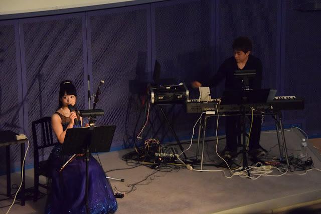 Ryuji Iuchi and Hiroko Suzuki on stage