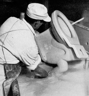 Twyfords - dipping a biscuit WC in a tub of glaze prior to 'glost' firing c 1930