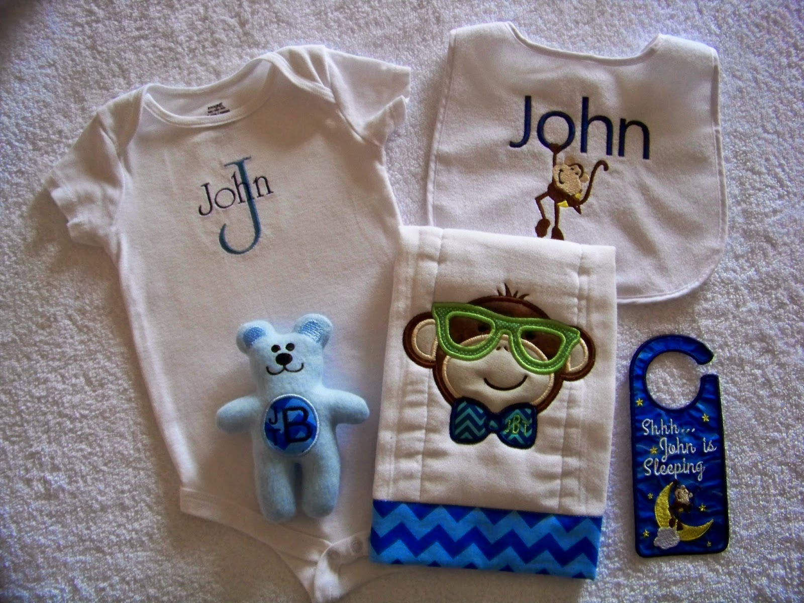 With glittering eyes embroidered onesie tutorial personalized in that spirit i wanted to provide some basic tutorials that would help others to use baby gifts to practice embroidery skills negle Choice Image