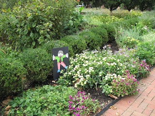 Flat Stanley in the flower bed