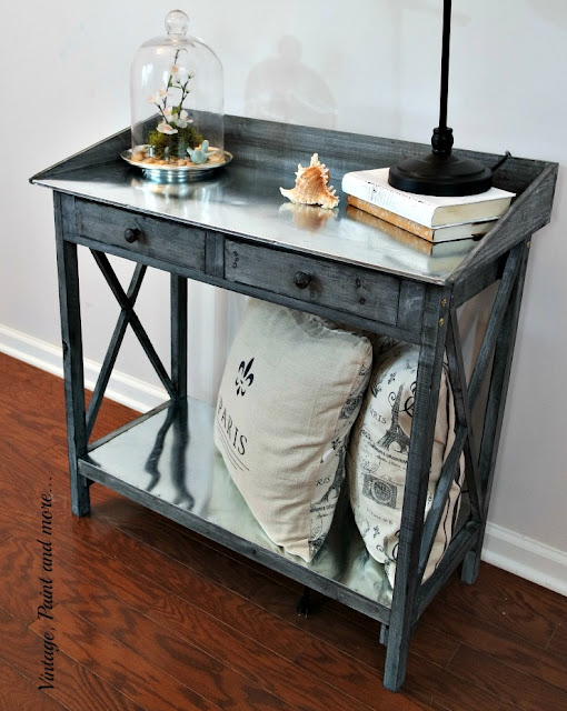 rustic vintage potting bench used as a table in an vintage industrial setting