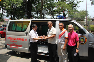 Modified vans serve as ambulances in the Philippines.