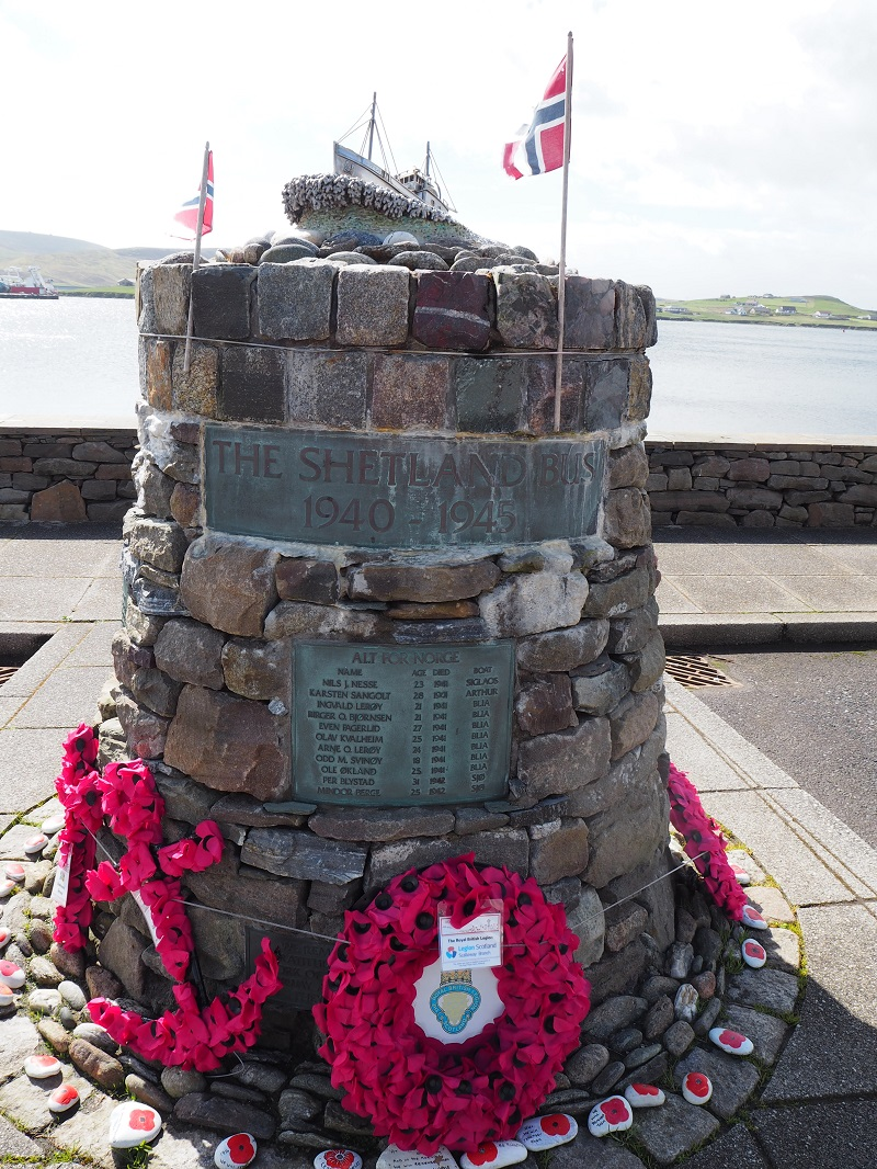 Shetland bus memorial with poppies