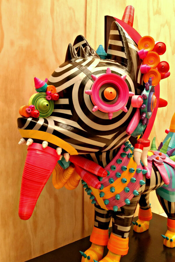 brightly colored rolled paper Xolotl Mexican dog sculpture