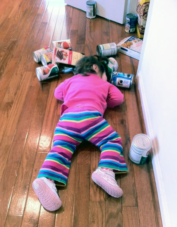 15+ Hilarious Pics That Prove Kids Can Sleep Anywhere - Napping After Playing In The Pantry