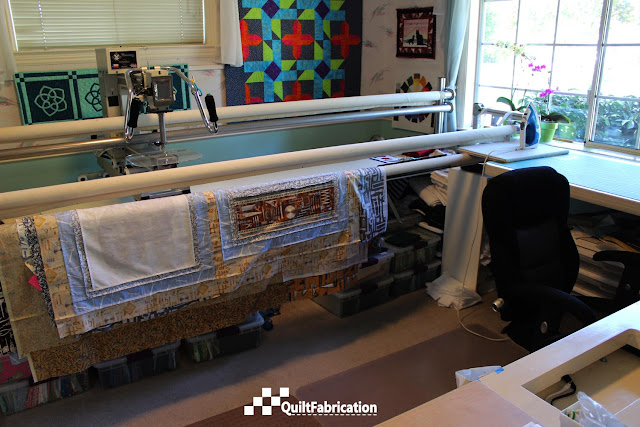 quilts hanging on Innova longarm frame