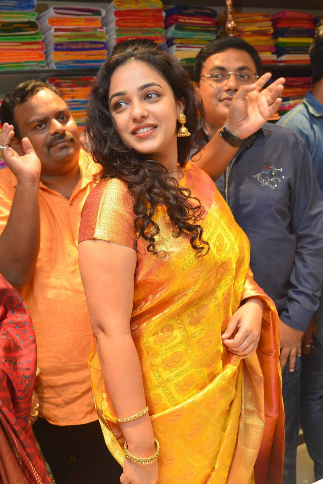 Nithya Menen Hot Smiling Hip Photos In Traditional Yellow Saree At Store Launch