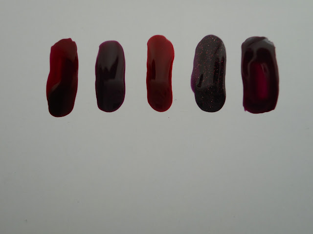 Left-to-right: Jessica #691 Street swagger, Essence #16 well plum!, Korres #59 Dark Red, OPI #926 Stir-fried Eggplant, Erre Due #254 Purple Rain