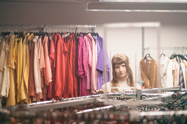 A girl stares in a thrift store