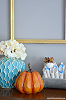 Nontraditional fall decor featuring blue and gold