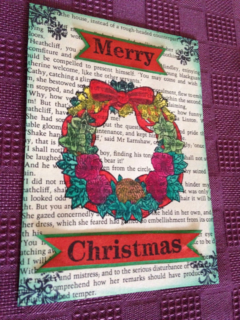 i used old book pages as the base for all of them and inked around the edges for the first one i stamped a wreath directly onto the book page and coloured