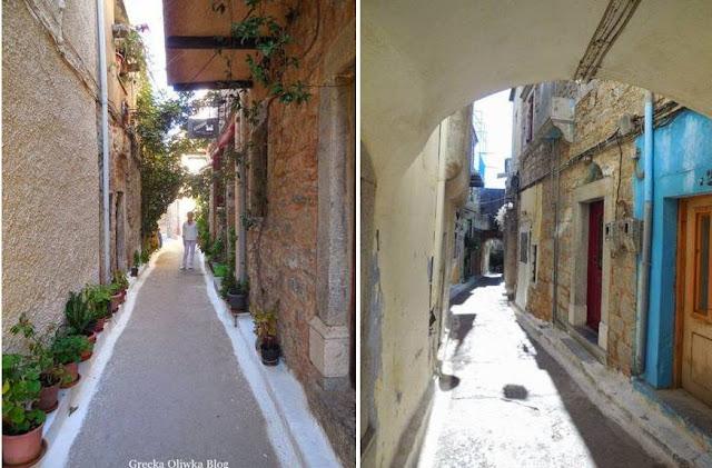 ulice udekorowane donicami, kwiaty, łuki, sklepienia, kamienice