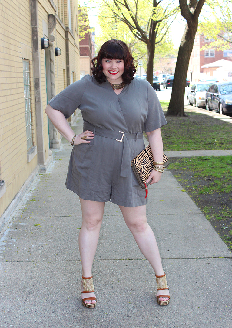 Plus Size Model Amber from Style Plus Curves in a khaki plus size romper and gold accessories