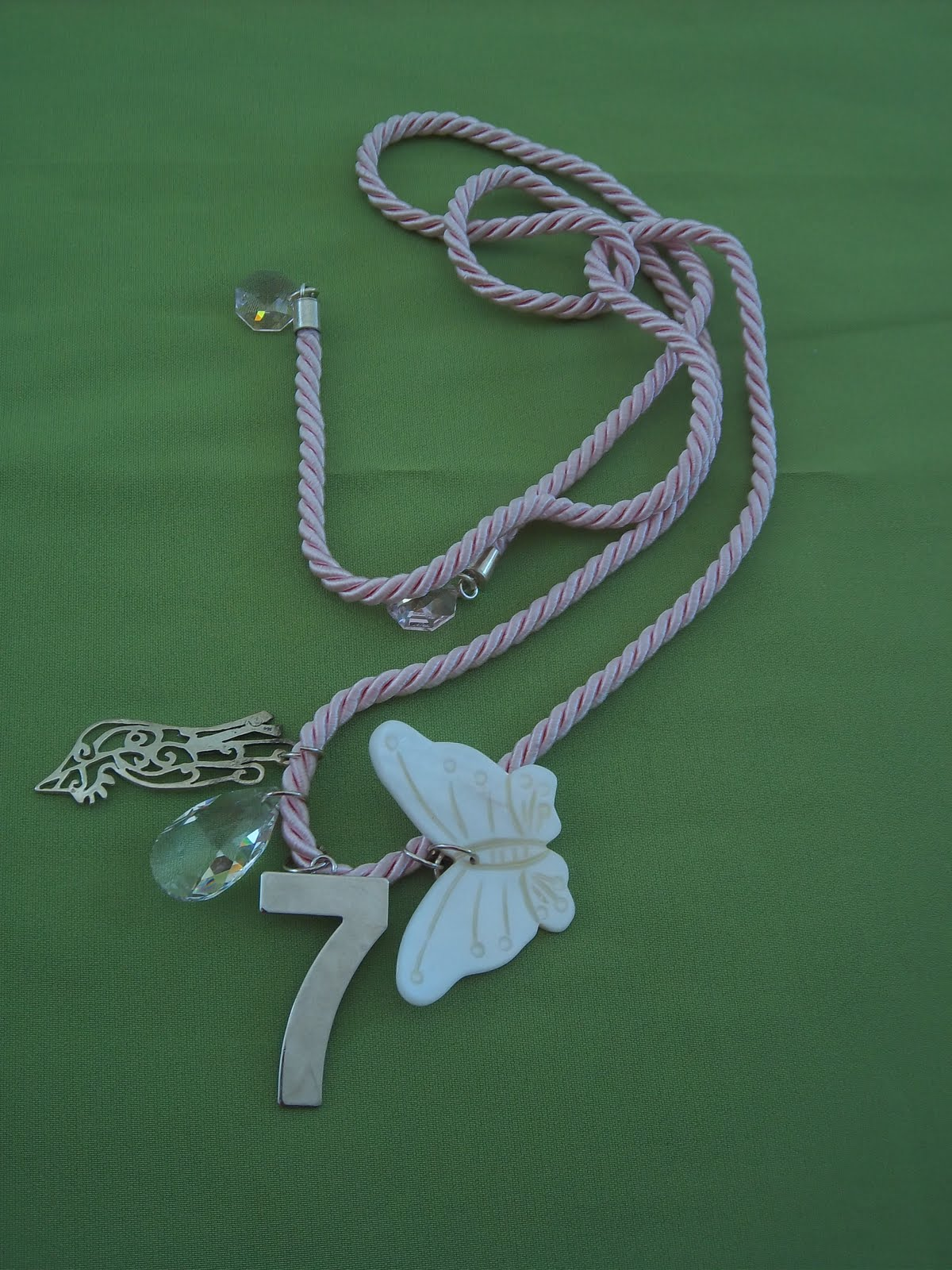 Κορδόνι μεταξωτό σε απαλό ροζ χρώμα με ακροδέκτες από ασήμι 925 και γνήσια  swarovski . Μια πεταλούδα από φίλντισι 4aea6eccd67