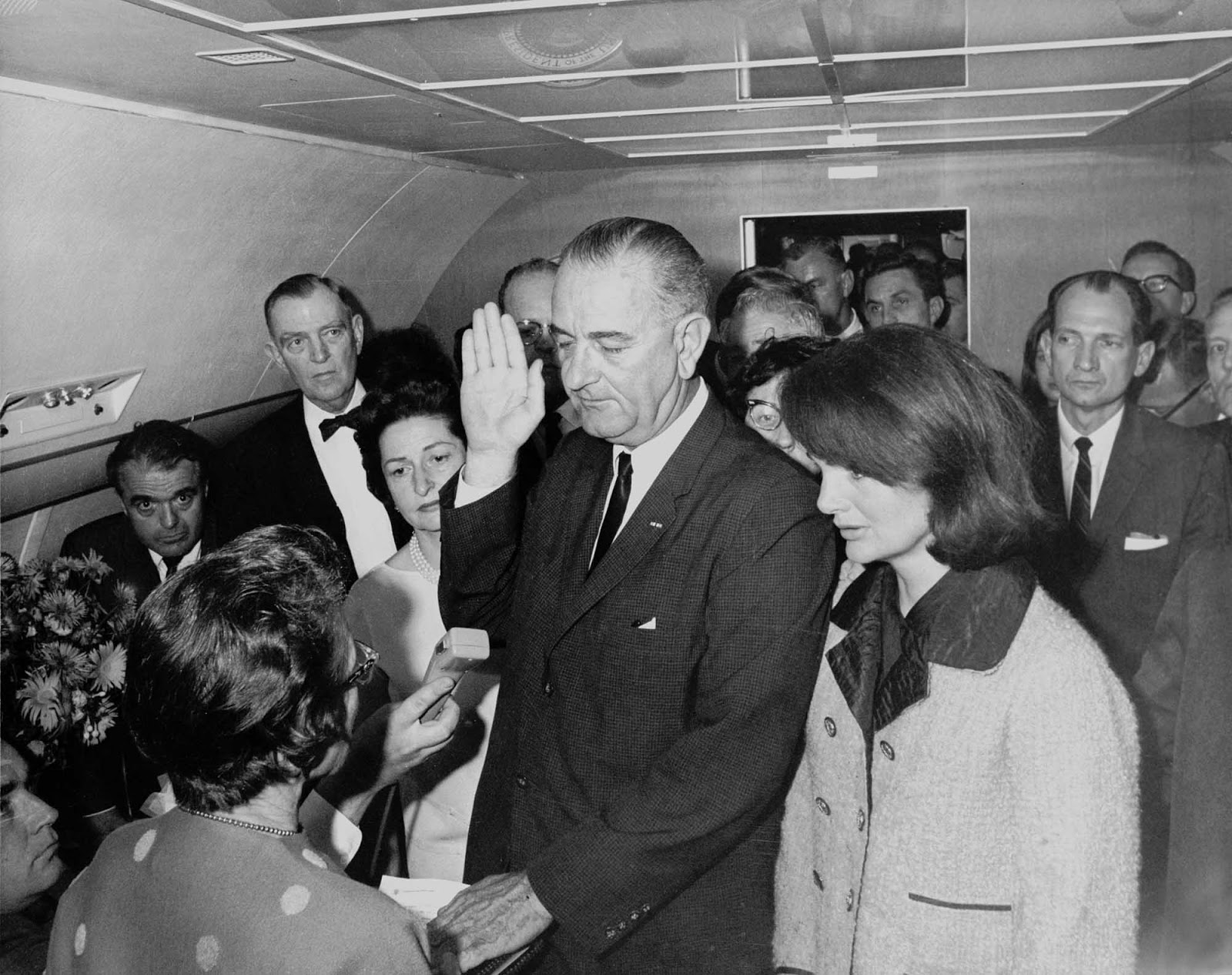 Flanked by Jackie Kennedy and his wife, Ladybird, Vice President Lyndon Johnson is sworn in as president of the United States of America by Dallas Federal District Judge Sarah T. Hughes on November 22, 1963.