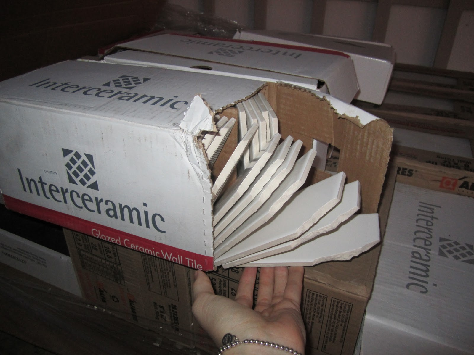 Broken Box And Tiles From Shipping