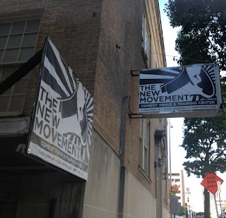 sign outside proclaiming: The New Movement
