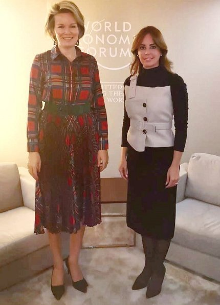 Queen Mathilde wore a brown and green tartan dress