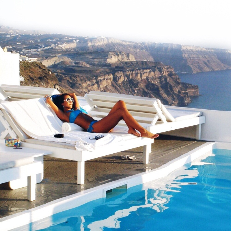 luxury travel blogger by the pool in Chromata hotel Santorini island