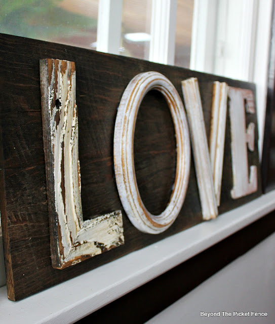 love sign with painted letters attached with a brad nail gun