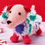 http://www.topcrochetpatterns.com/free-crochet-patterns/snowy-the-dachshund