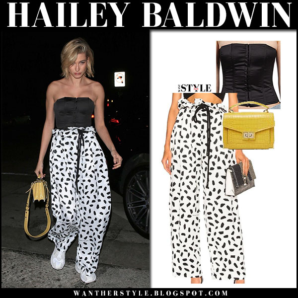Hailey Baldwin in black corset and white printed pants off-white model street style march 27