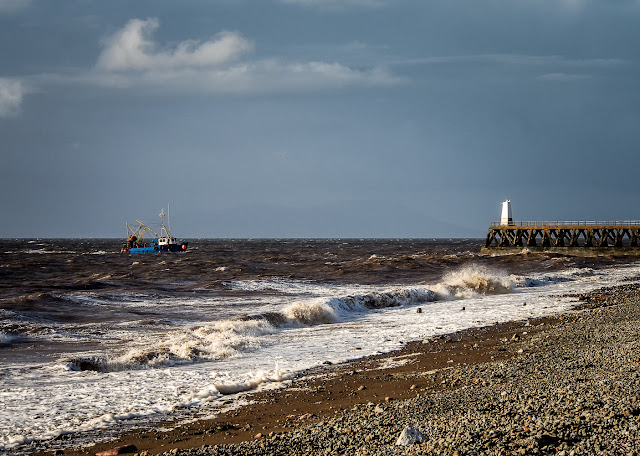 Photo of a fishing boat returning to Maryport in rough seas