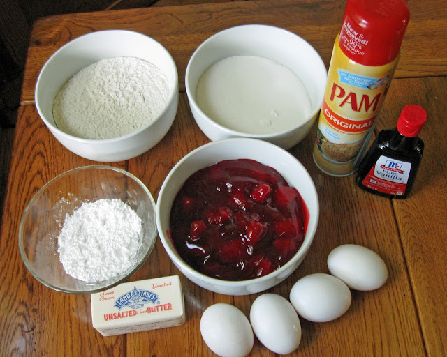 These are the ingredients for strawberry squares - butter, sugar, eggs, vanilla extract, flour, strawberry pie filling, confectioner's sugar baking spray.