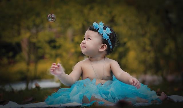 baby looking at the bubble
