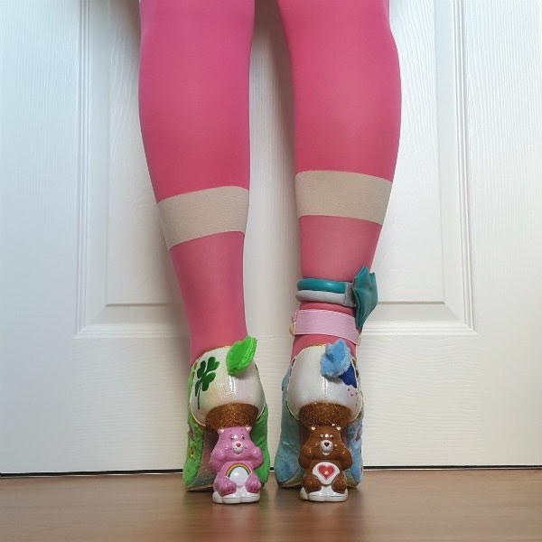 back view of care bear heeled shoes with fluffy tails