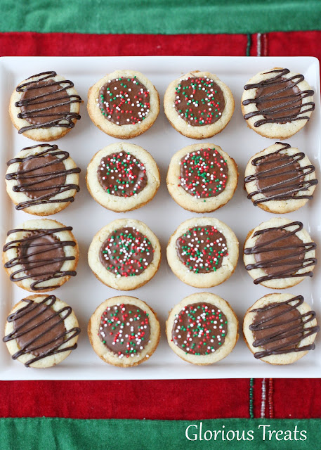 peanut butter cup cookies plated with red and green sprinkles and drizzled with dark chocolate
