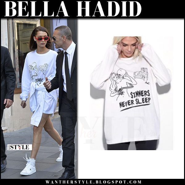 Bella Hadid in white oversized sweatshirt, white sneakers and red sunglasses illesteva vinyl what she wore may 24 2017 rome