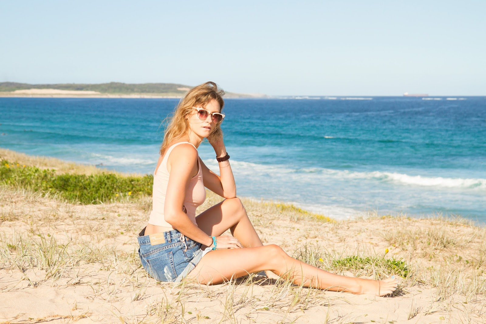 fashion blogger Alison Hutchinson wearing an Urban Outfitters crop top and One Teaspoon Pacifica Bandits at Cronulla Beach, Sydney
