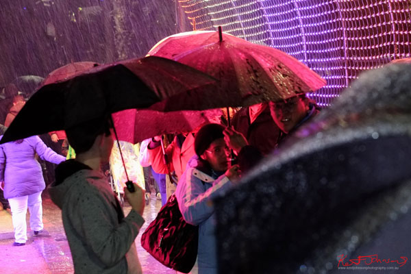 Heavy rain and umbrellas - Hundreds and Thousands light tunnel at Vivid Sydney 2013 - Fujifilm X-Pro1, XF35mmF1.4 R.