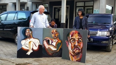 Lawyer Julian McMahon with three self-portraits by Myuran Sukumaran