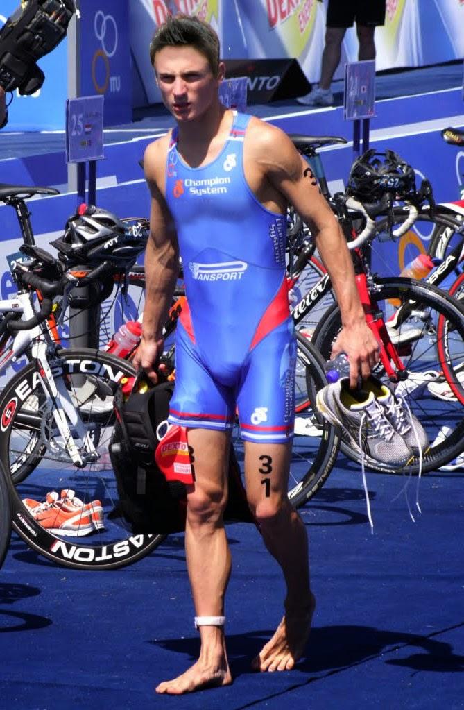 Male Athletes World: Triathlon: A triathlete walking in