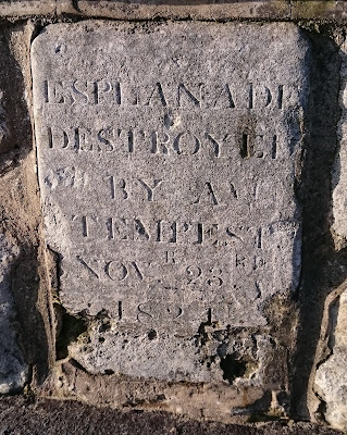 A stone on Weymouth seafront commemorating  the destruction of Weymouth esplanade in 1824