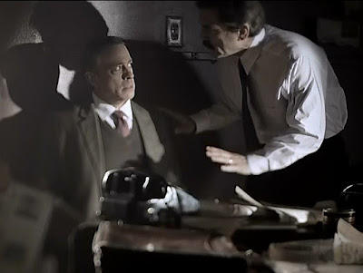 Man (Josef Jakobs?) being questioned by other man (MI5 officer?) (Screenshot - Mysteries at the Museum)