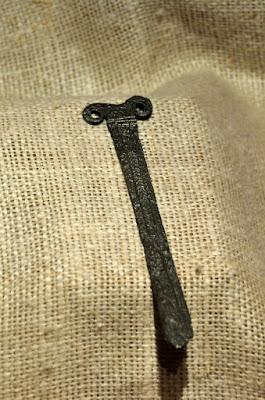 nóż wolutowy z Biskupina