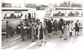 Women students disembarking from bus on the Green