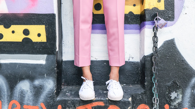 Pink and white Vans worn by fashion blogger Reena Rai
