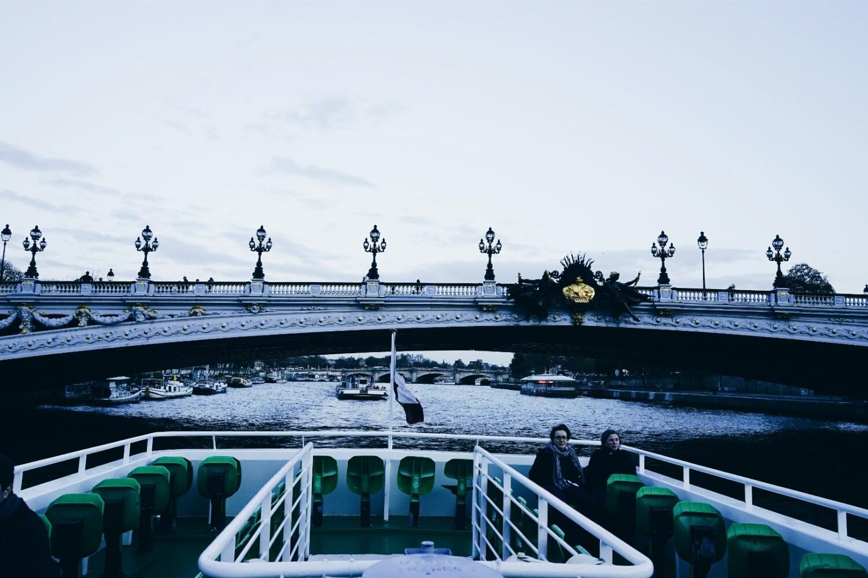 Seine River Cruise passing through the Alexandre III bridge