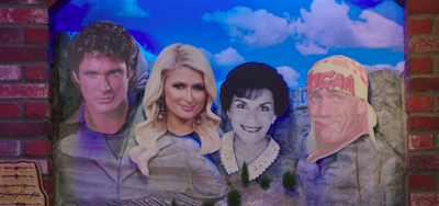 a picture of Mount Rushmore where the presidents have been replaced by David Hasselhoff, Paris Hilton, Judge Judy, and Hulk Hogan