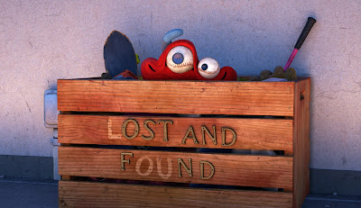 Lou, peaking out from his lost and found box
