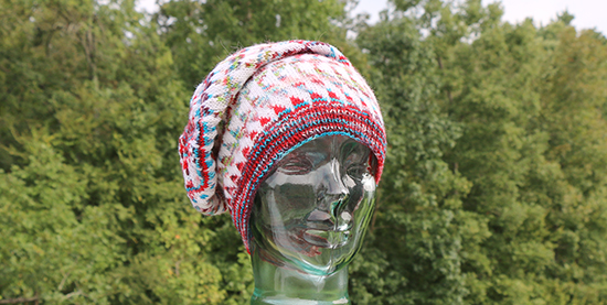 Front View of Knit Dingle Hat Worn with Crown Flopped to the Side