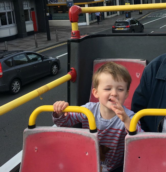 Cardiff-City-Sightseeing-open-top-bus-tour-a-toddler-explores-building-toddler-on-bus
