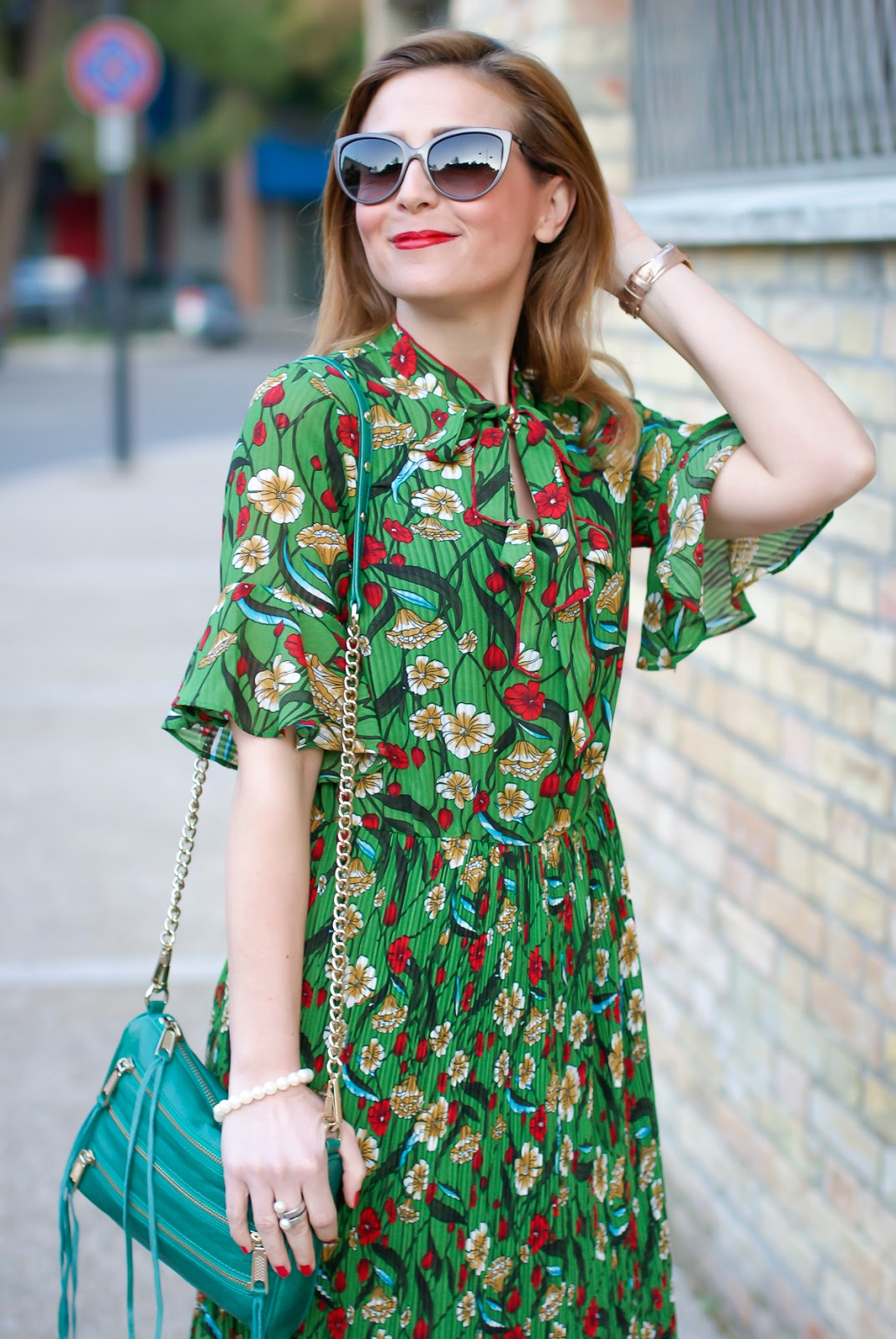 Metisu green pleated midi dress with flared sleeves on Fashion and Cookies fashion blog, fashion blogger style