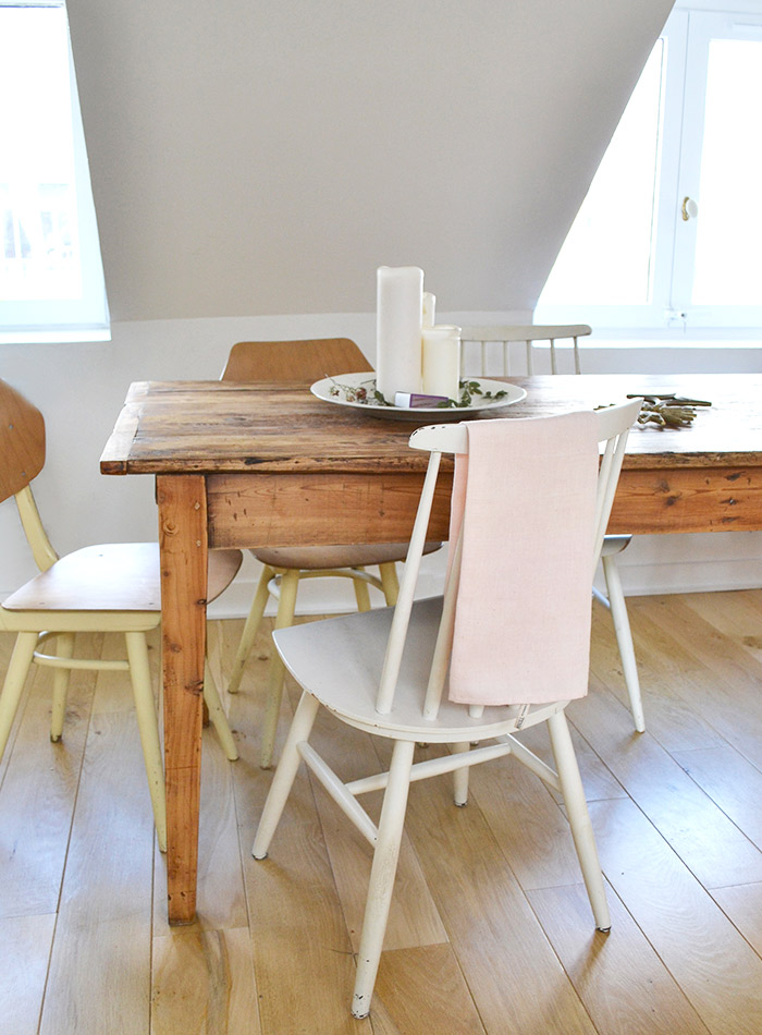 Wood harvest table and vintage chairs in 1650 Marais Paris kitchen of Lucille Gauthier-Braud. #farmtable #cottagestyle #farmhousestyle